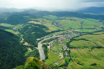 view from Three Crows hilltops, village Cerveny Klastor (Slovakia) and Sromowce Nizne (Poland) divided by river Dunajec